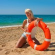 Beautiful lifeguard at sea — Stock Photo