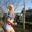 Sexy Girl holding a chainsaw — Stock Photo