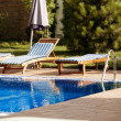 Stock Photo: Chaise lounge near pool