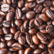 A background from delicious and fragrant coffee beans - Stock Photo