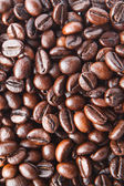 A background from delicious and fragrant coffee beans — Stock Photo