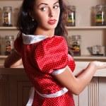 Beautiful girl in a red polka-dot dress — Stock Photo