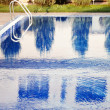 Swimming pool with stair at hotel close up — Zdjęcie stockowe #14061451