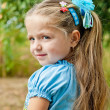 A beautiful little girl in a field — Stock Photo