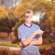 Man smoking a cigarette outside - Foto Stock