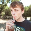Young man drinking water, outdoors — Stock Photo
