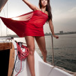 Beautiful young girl on a yacht — Stock Photo