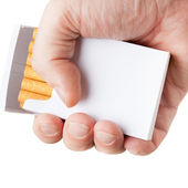 Pack of cigarettes in hand, isolated on white background — Stock Photo