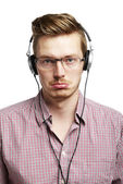 Listening and worried with headphones — Stock Photo
