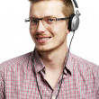 Постер, плакат: Listens and smiles with headphones