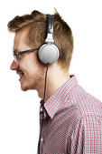 Listening with headphones — Stock Photo