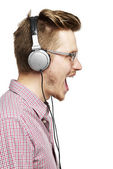 Listening to music and singing with headphones — Stock Photo