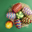 Stock Photo: Easter eggs in hay