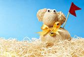 Easter lamb in hay — Zdjęcie stockowe