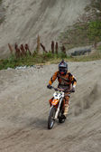 KIROVSK,RUSSIA-AUGUST 24: Races competitions on motorcycles on a cross-country terrain  in the city of Kirovsk, Russia, AUGUSTUS 24 2013. In Russia the youth actively is engaged in technical sports — Stock Photo