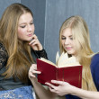 Two girls reading a book — Stock Photo