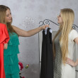 Two girls trying on dresses — Stock Photo