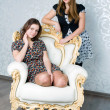 Stock Photo: Two girls are sitting in a chair