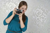 Beautiful girl with photocamera — Stock Photo