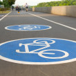 Stock Photo: Bicycle road sign on asphalt. Leisure activities