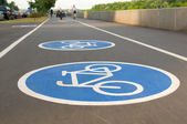 Bicycle road sign on asphalt. Leisure activities — Stock Photo