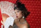 Retro Woman Portrait. Beautiful Woman with a Fan — Stock Photo