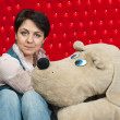 Woman with her toy doggy — Stock Photo