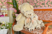 Three teddy bear on the couch. Tender pink and white interior — Stockfoto