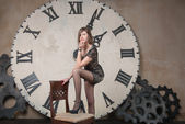 Young woman on the background of the clock — Stock Photo