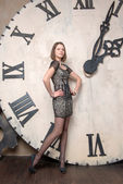 Young woman on the background of the clock — 图库照片