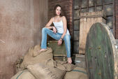 Young beautiful woman in dilapidated warehouse — Stock Photo