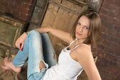 Portrait of beautiful girl in grunge interior — Stock Photo