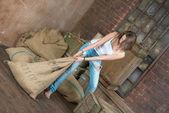 Beautiful girl drags heavy sack — Stock fotografie