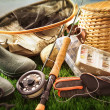 Foto Stock: Fly fishing equipment on grass
