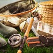 Foto de Stock  : Fly fishing equipment on grass