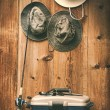 Hats hanging on wall with fishing equipment - Foto Stock