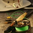 Fishing reel and hat on bench — Stock Photo #12020813