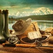 Royalty-Free Stock Photo: Fly fishing equipment on deck with view of a lake and mountains