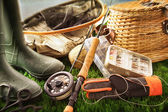 Fly fishing equipment on grass — Stok fotoğraf