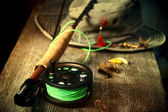Fly fishing equipment with old hat on bench — Stok fotoğraf