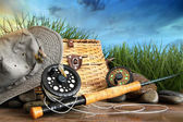 Fly fishing equipment with hat on wooden dock — Stok fotoğraf