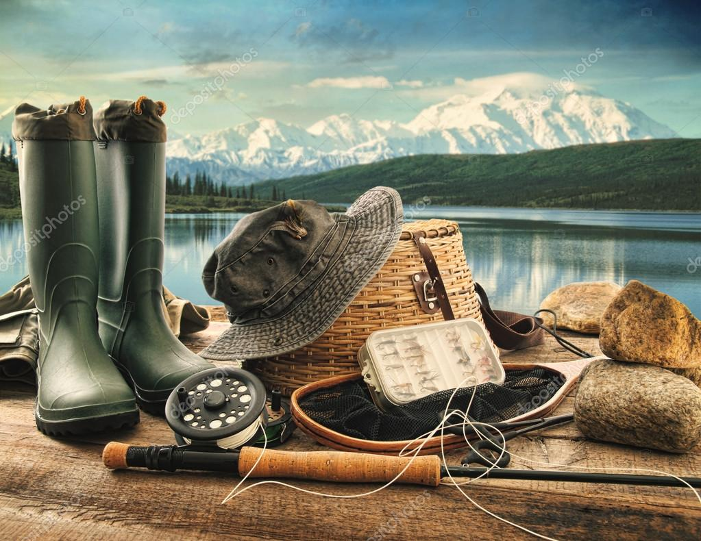 Fly fishing equipment on deck with beautiful view of a lake and mountains — Stock Photo #12020724
