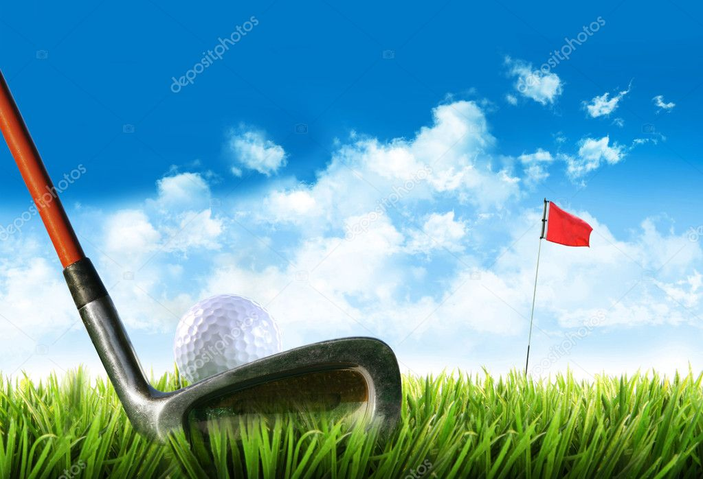 Golf ball with tee in the grass against blue sky  Stock Photo #12020754