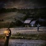 Eerie night scene with Halloween pumpkin on fence — Stock Photo