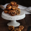 Cinnamon pinwheel rolls on cake stand - Stock Photo