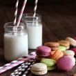 Macaroons with jar glasses and straws - Stock Photo