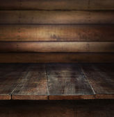 Old wooden table with wooden background — Stock Photo