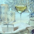 Stock Photo: Festive dinner setting with gift for holidays