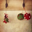 Holiday ornaments hanging on antique wall hooks — Stock Photo #16161523