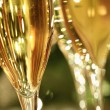 Golden champagne sparkle — Stock Photo
